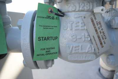 A green tag is added to equipment to signify it has been turned over from construction to startup for testing.